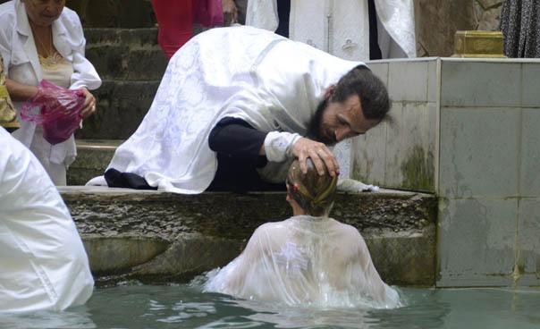 Более ста человек приняли  крещение в лесных родниках